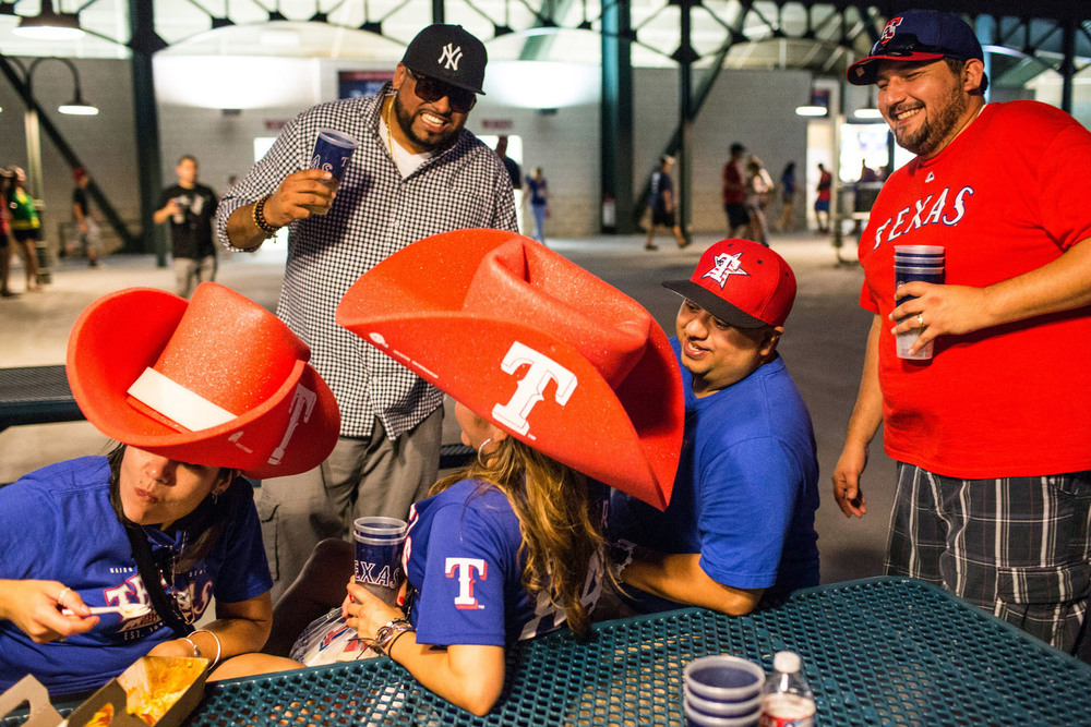 From left, Jessica, Tom, Linda, Turtle and Ray share a laugh on the outfield concourse at Globe Life Park in Arlington, TX.