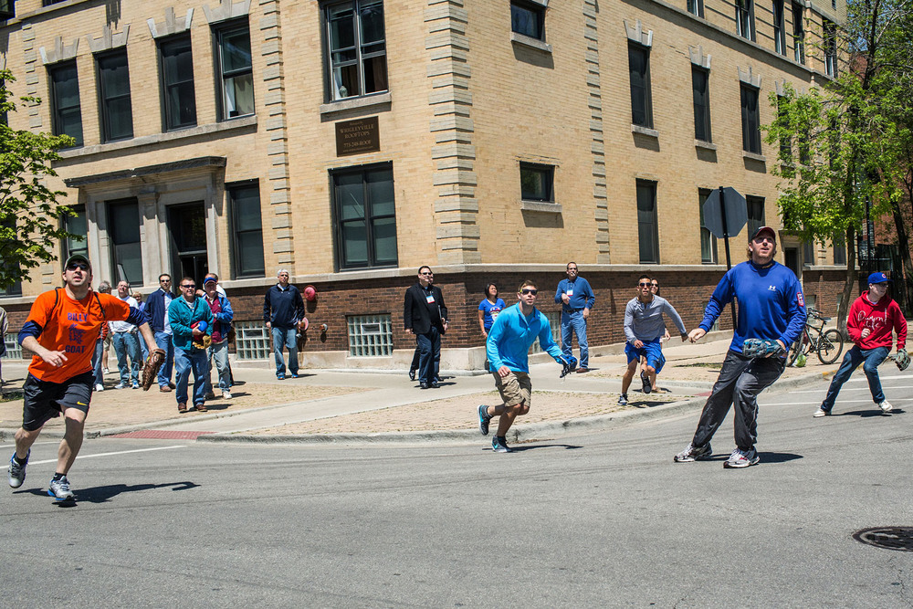 Fans shag balls on Waveland Avenue  during batting practice at Wrigley Field in Chicago, IL .Dave Davison, second to the right, has collected more than 5000 balls in more than 20 years.