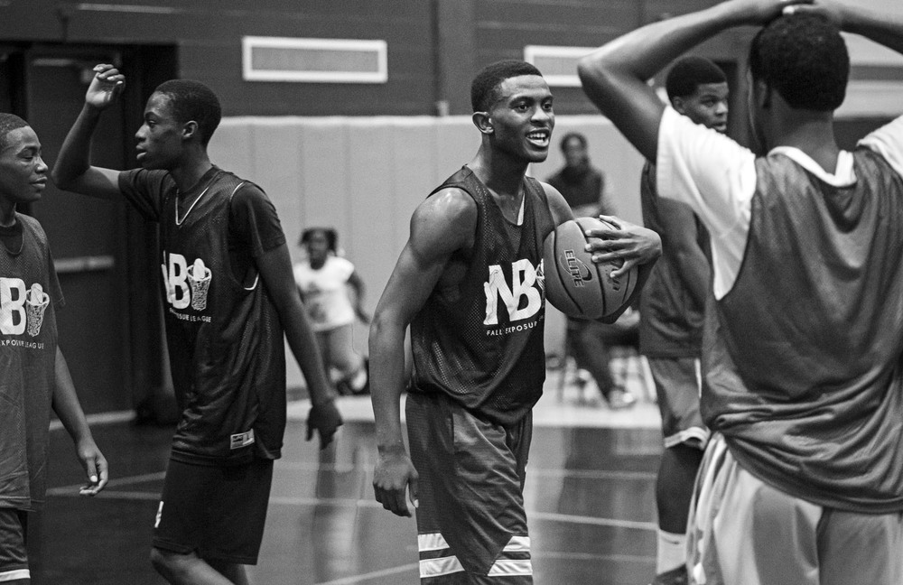 "Augustin celebrates after Uplift High School beat Simeon Career Academy in an NBU Fall Exposure League game. The game served as a measuring stick for how good the team could be: Simeon was the four-time reigning state champion and is considered a contender for the upcoming season. ""We beat Morgan Park. We beat Simeon. Little by little, our name is getting out there,""  he said. ""If we keep winning, that's going to help us."""