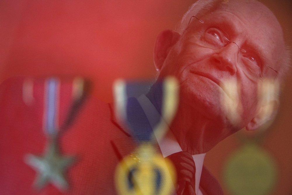 D-Day veteran William C. Scott stands reflected in the three medals he received for his service: a Bronze Star, Purple Heart and Good Conduct Medal.