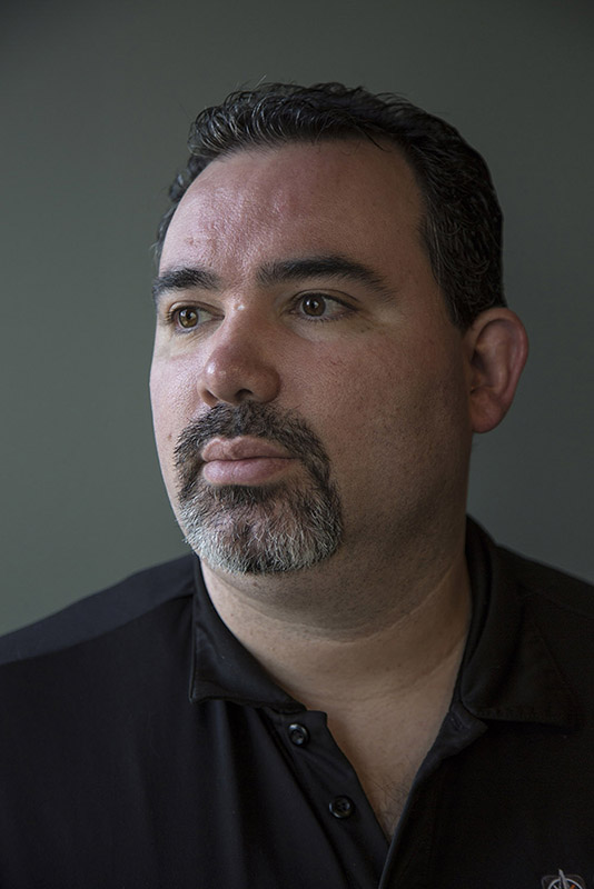 "Antonio Rodriguez poses for a portrait at his workplace, Omnium Management Group on January 24, 2017. ""It can't be worse than it is now,"" Rodriguez said of the Affordable Care Act. ""I got my family covered under a HealthCare.gov plan but the deductibles and out of pocket are so much that we're being forced to go down to one car and possibly sell our home to pay medical bills."" Story: https://www.nytimes.com/2017/01/29/health/obamacare-affordable-care-act-lifesaver-burden-voices.html"
