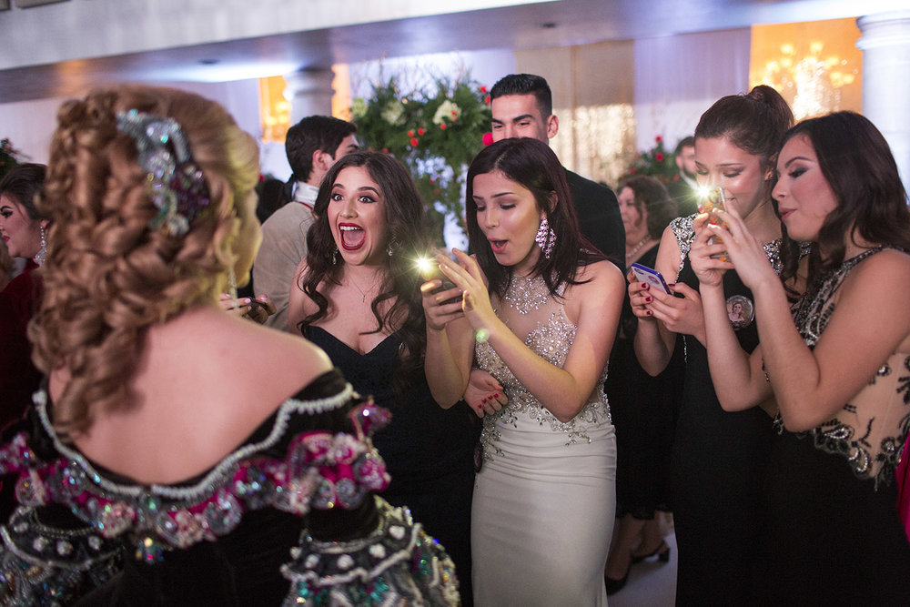 From left, Carolina Angers, Karina Garcia, Karla Garcia, and Gizella Lopez react to seeing Sofia Perez at the The Society of Martha Washington Colonial Ball in Laredo, TX, United States on February 17, 2017.