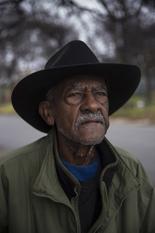 "John Roland, 86, moved from San Antonio to the East Side neighborhood in Austin in the 1960s to take care of his ailing father. ""I remember when white folks didn't come this side of 35,"" he said. Almost every morning, he buys a lottery ticket and has breakfast at Taco-Mex. Afterward, he goes to see his girlfriend of 30 years. He said both he and his girlfriend agreed early on that neither of them wanted to get married and that each wanted to have their own living space. He posed for portrait near 12th and Harvey streets in Austin, Texas on January 14, 2017."
