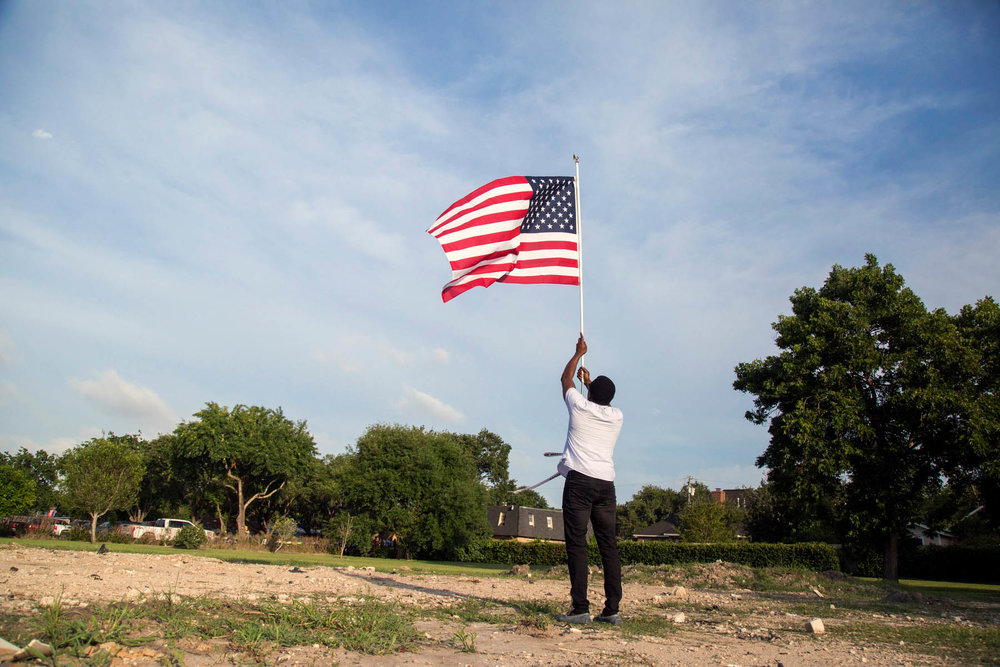 Kehinde Olurode, a board member at the Victoria Islamic Center, raises a flag on the grounds where the Victoria Islamic Center will be rebuilt in Victoria, Texas on May 27, 2017. Ray Whitehouse / for BuzzFeed