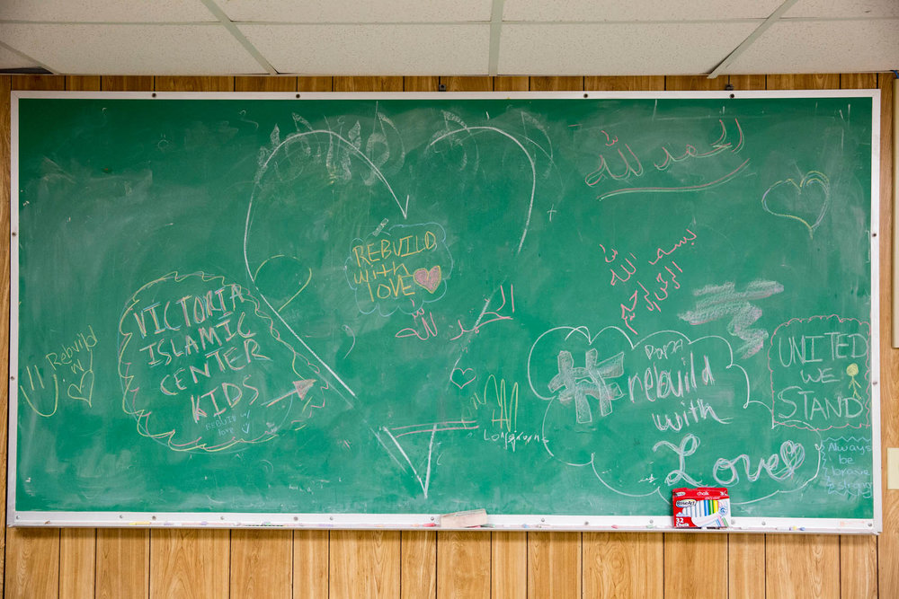People wrote messages on the chalkboard in the temporary mosque on February 7, 2017.