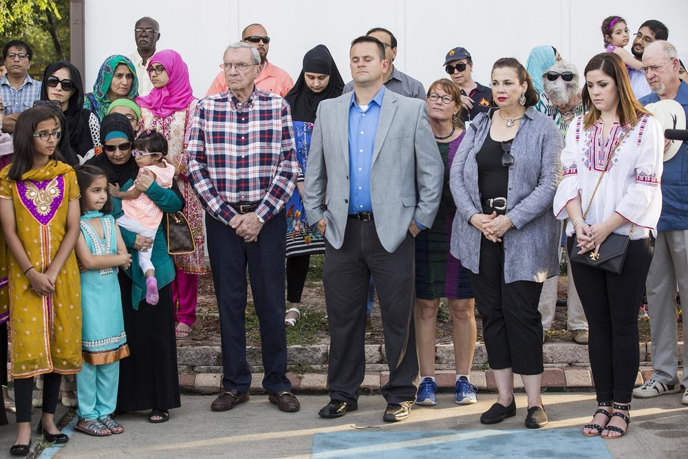 People pray during a ceremonial groundbreaking ceremony for the new Victoria Islamic Center in Victoria, Texas on May 27, 2017.