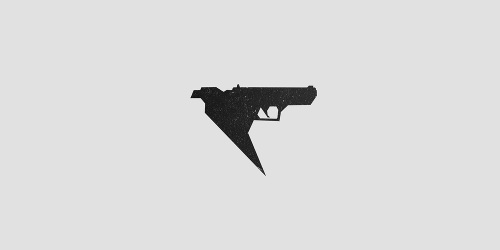 The outline of the gun that makes up the eagle's wings in the logo is a based off an actual pistol called the Baby Desert Eagle. I just realized how cheesy that idea was while typing it out...