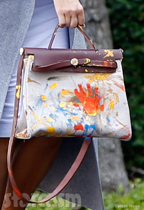Kim Kardashian carries a Hermes bag painted by North West on Monday, Nov. 9