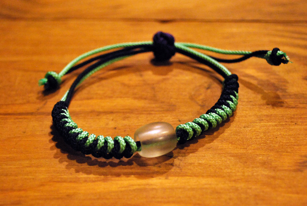 Knotted Bracelet      - Colors:  Green & BlackStarting bid:  $30Current highest bid:  $40To place a new bid: $45+