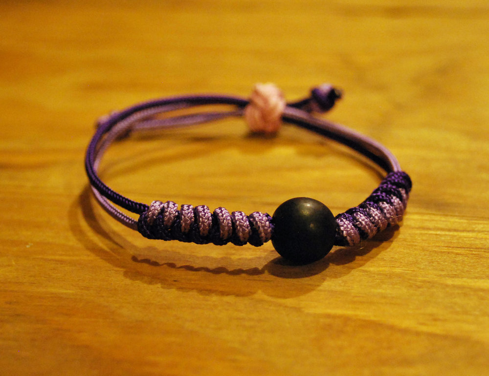 Knotted Bracelet      - Colors: Lavender & PurpleStarting bid:  $30Current highest bid:  $45To place a new bid: $50+