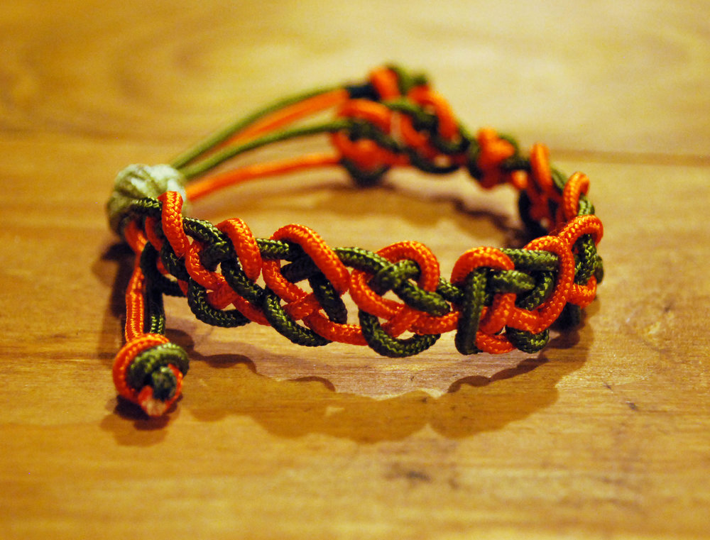 Knotted Bracelet  - Colors:  Orange & GreenStarting bid:  $30Current highest bid:  $40To place a new bid: $45+
