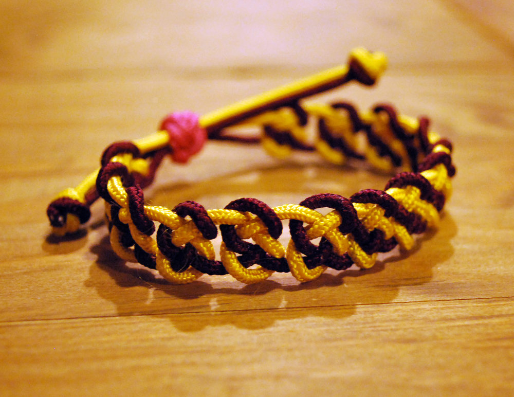 Knotted Bracelet     - Colors:  Crimson & YellowStarting bid:  $30Current highest bid:  $40To place a new bid: $45+