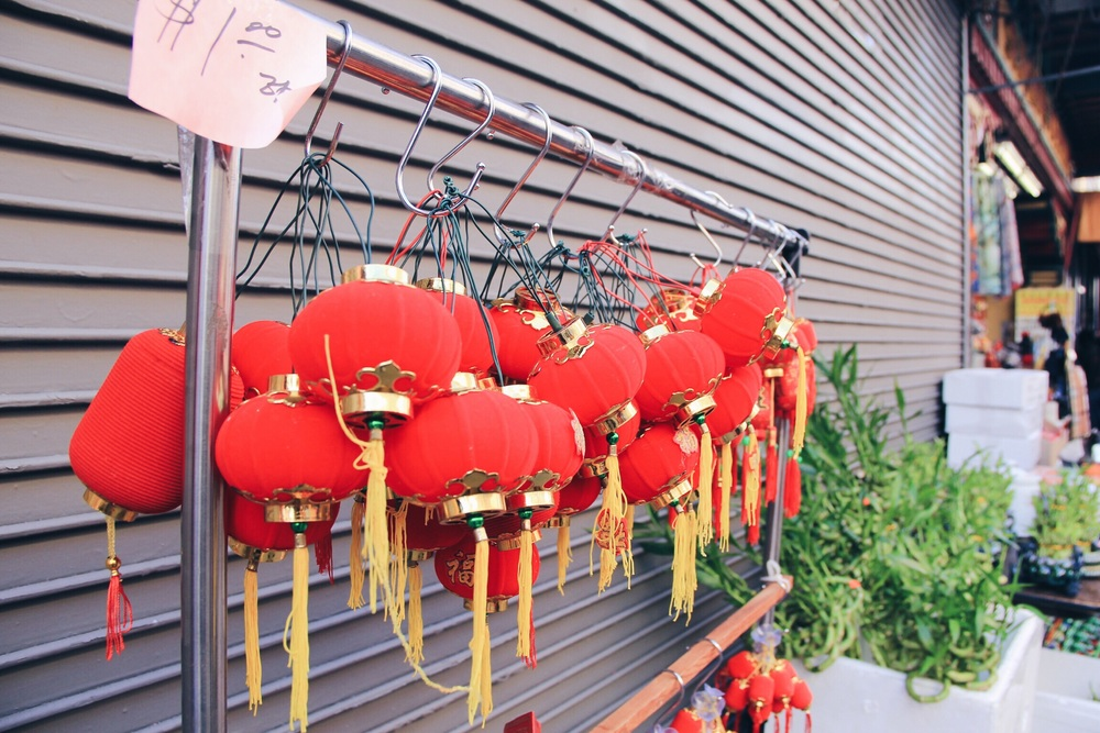 red lanterns hang outside a shop in Chinatown