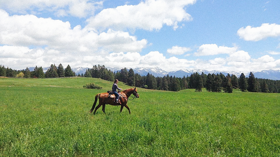 Mandy Mohler and Ben the Horse riding in Montana