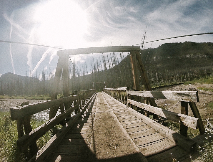 Crossing the final pack bridge to Benchmark Trailhead, Bob Marshall Wilderness, Montana