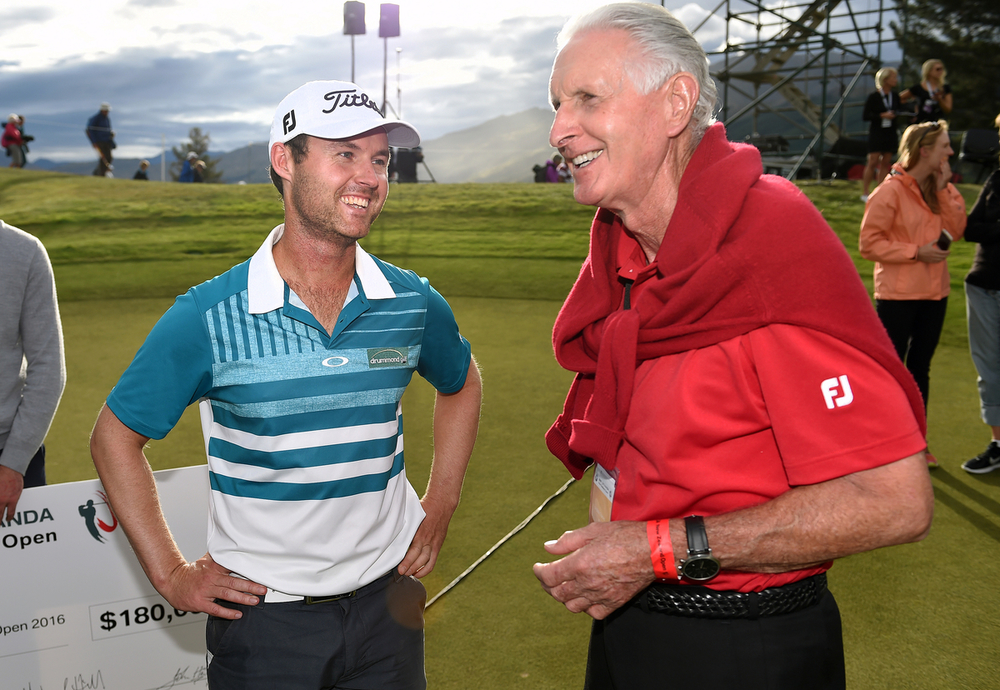 New Zealand Open winner Matthew Griffin (left) chats with New Zealand golf legend Bob Charles. Photo: Simon Watts/BW Media