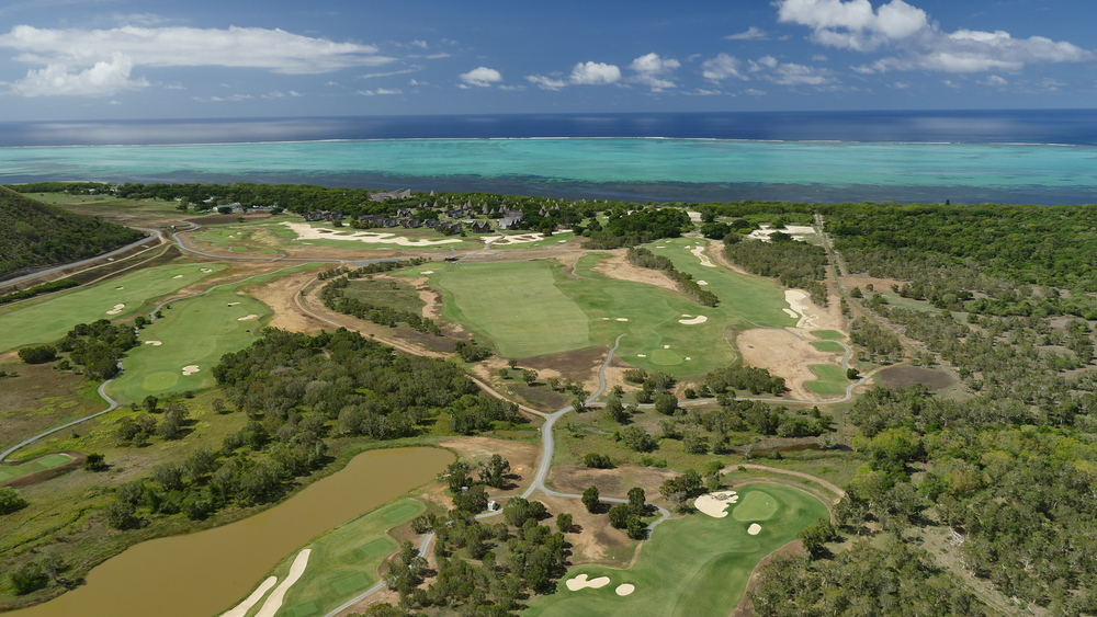 Aerial shot of Deva Golf Course and the Sheraton Deva in the background on the shores of the lagoon.