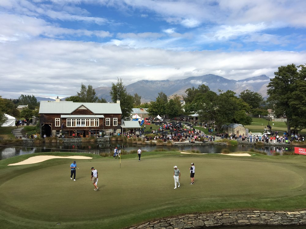 Players and caddies on the 18th green at Millbrook during this year's New Zealand Open.