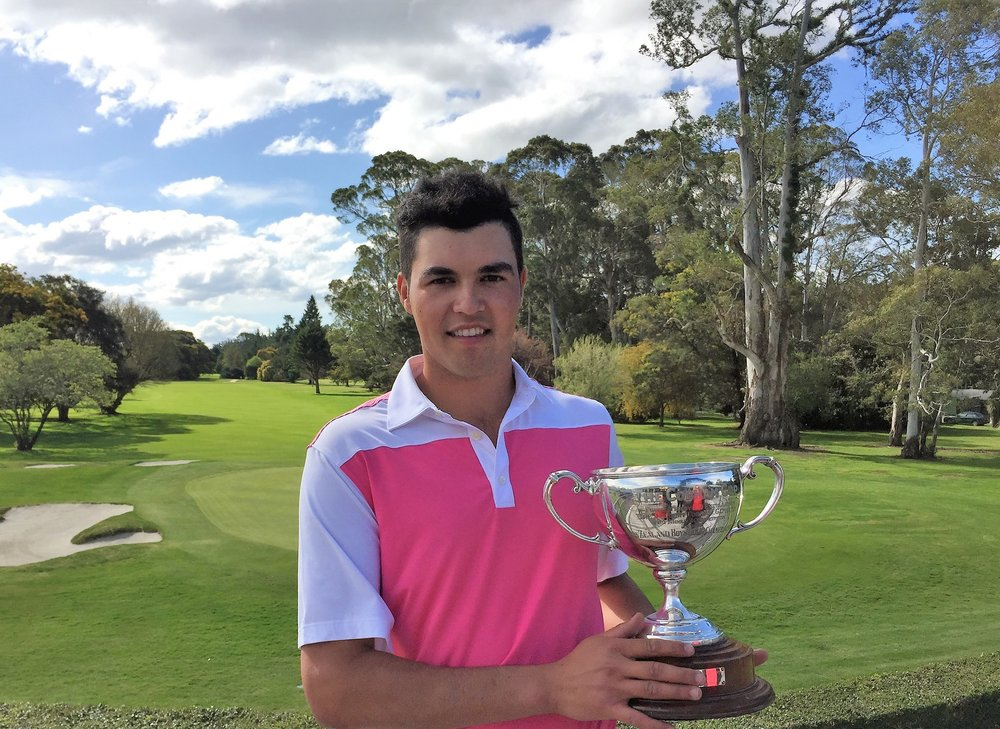 Mako Thompson with his trophy after winning the New Zealand Age Group Championship.