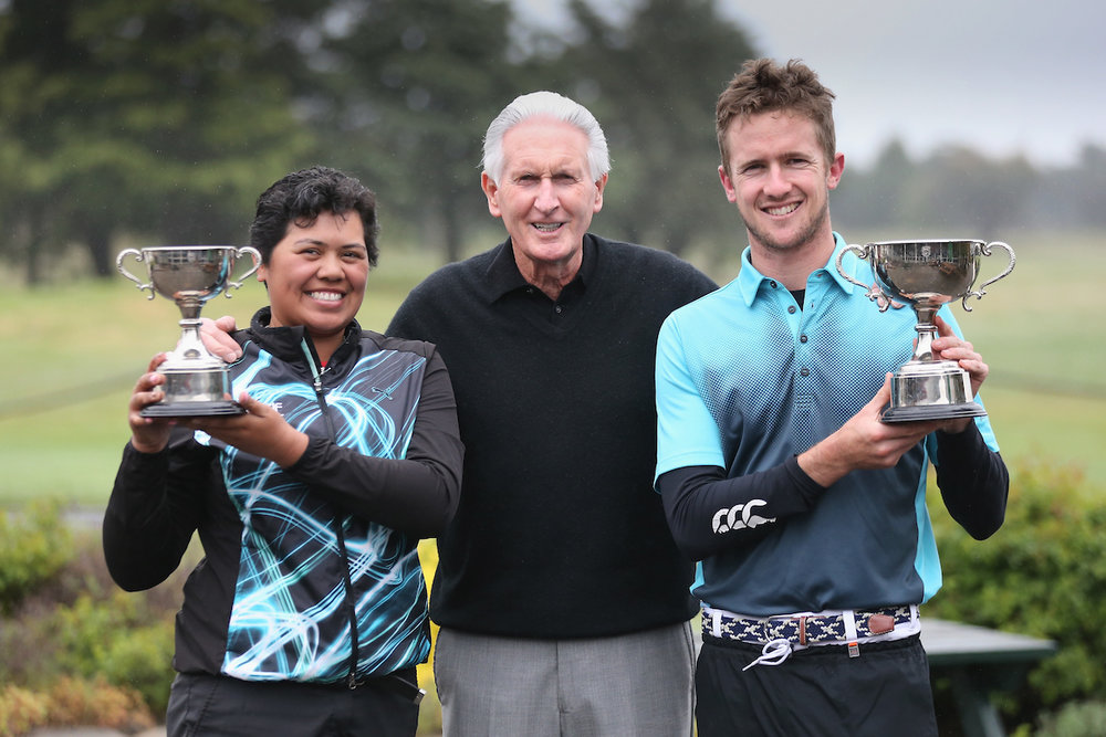 New Zealand golf legend Bob Charles is flanked by Chantelle Cassidy and Harry Bateman following their wins in the Harewood Open in Christchurch