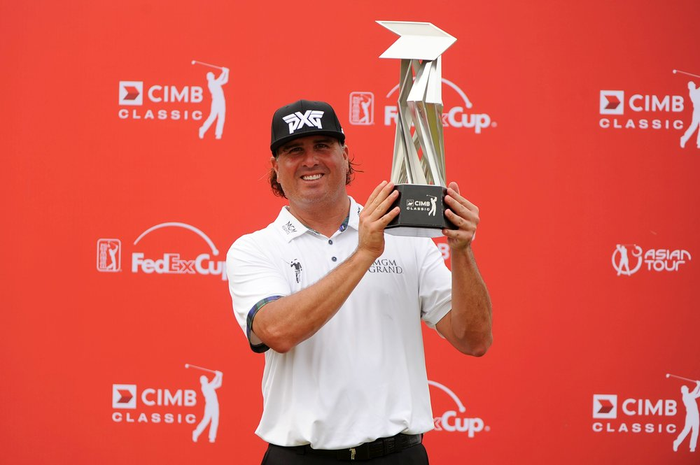 Pat Perez holds the trophy aloft after winning on the PGA Tour in Malaysia at the age of 41