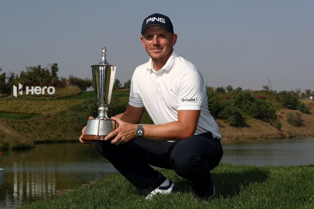 Matt Wallace, of England, holds the trophy aftef winning the Indian Open. Photo: Asian Tour
