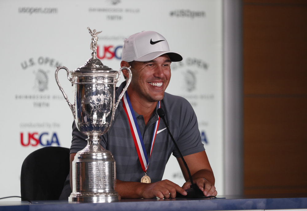 Brooks Koepka with the trophy during a news conference after winning the US Open at Shinnecock Hills Golf Club in  New York PHOTO USGA/Darren Carroll