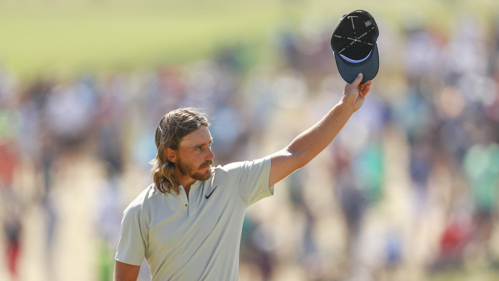 Tommy Fleetwood waves to the crowd on the 18th green following his brilliant final round in the US Open PHOTO USGA/Chris Keane