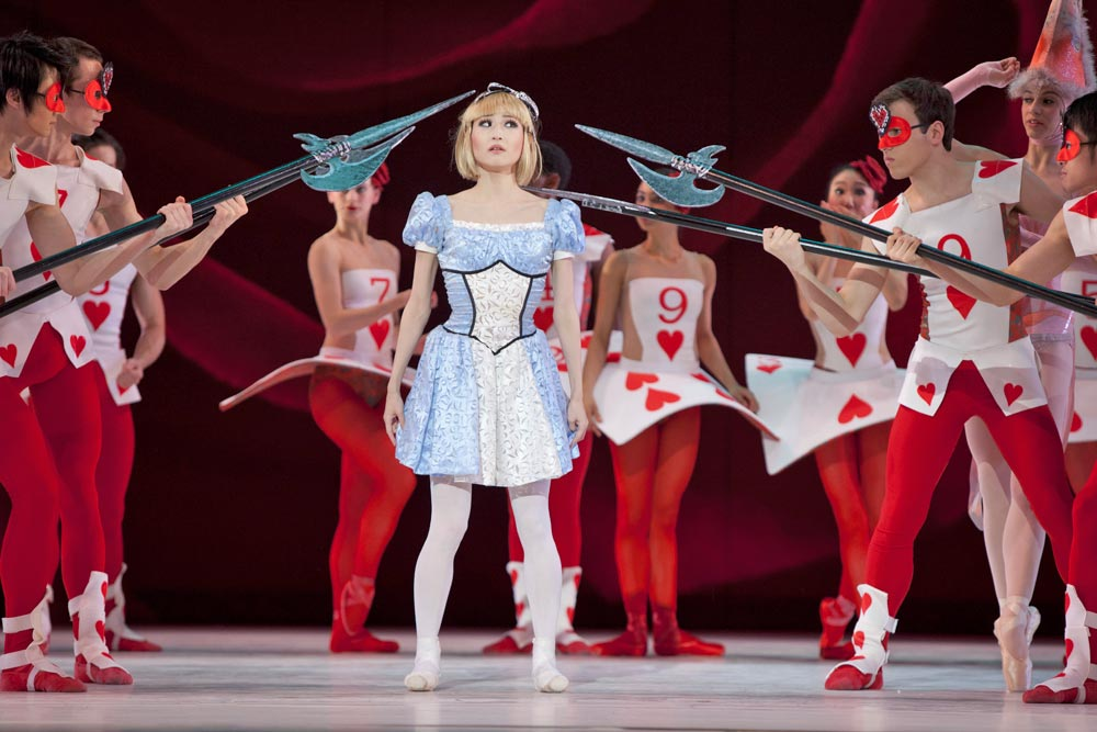 Maki Onuki (Alice) amongst the Card Guards in The Washington Ballet's Alice (in Wonderland). Photo Credit: Brianne Bland
