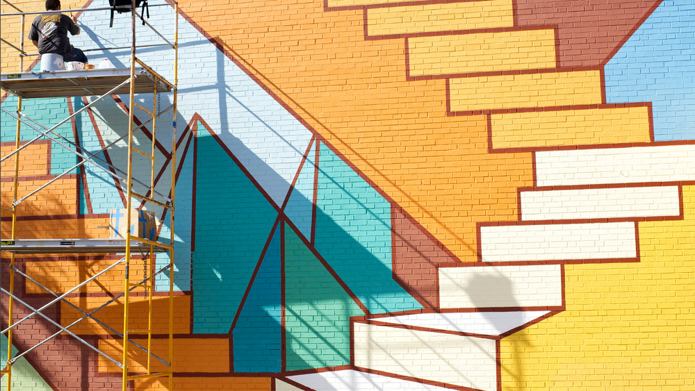 Above: 'Staircases and Mountaintops' the mural by Amber Artist, Will Humphrey, shown in-progress before it's grand reveal in Fall 2014.