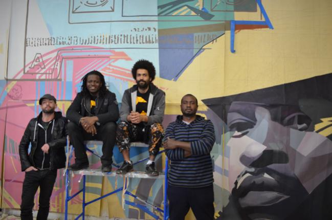 "A few members of the Amber Art & Design in the studio, where the Roots mural is taking shape. Pictured are (from left)  Charles Barbin, Ernel Martinez, Keir Johnston and Willis ""Nomo"" Humphrey.  (Photo: J.R. Blackwell)"