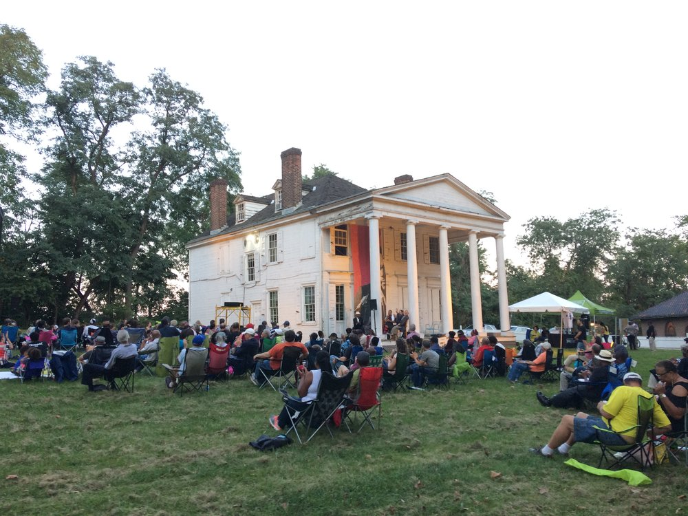 Crowds enjoying an outdoor movie, concert, and vigil honoring the life of John Coltrane with the  Philadelphia Jazz Project .