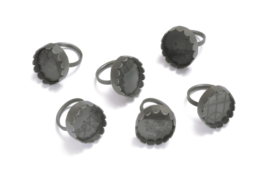 Sim Luttin, Moment of Truth Rings, 2015. Silver, glass, digital photo on archival paper; oxidised. Dimensions unknown. Photographed by Andrew Barcham. Reproduced with permission of artist.