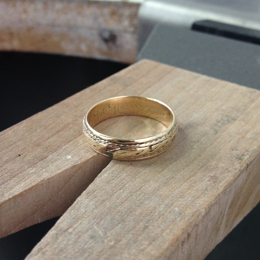 The original ring complete with engraving and sharp bit of gold 'rope' sticking out