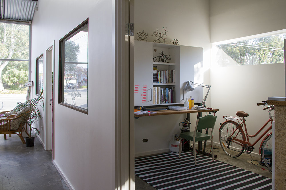 My studio on the right with my awesome new cupboard (found on gumtree) which has pegboard storage cupboards as well as a retractable solid wood bench top. Photograph courtesy of  Bianca Hoffrichter.