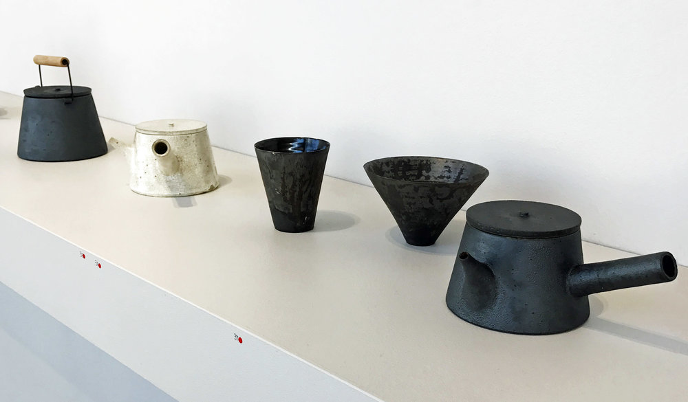 Yoko Ozawa  has used a subtle combination of matte and gloss glazes in her collection of black and white stoneware. These are some of my favorite pieces out of the whole show and my photographs do not do them justice.