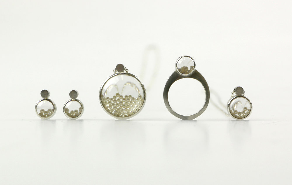 My sterling silver Microscope range is available for sale through Naomi's gallery. Each piece features a collection of tiny fresh water pearls which move freely behind a magnifying lens.