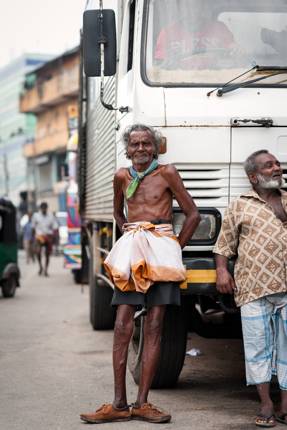 Old Man Leaning on Truck, Colombo