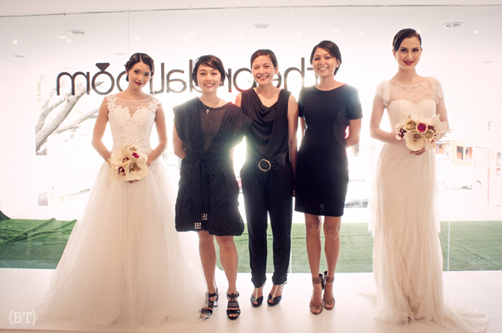 Live mannequin models holding paper flower bouquets, standing alongside the owners of The Bridal Room, sisters Mica Tantuico, Anna Tantuico, and Raisa Vargas.