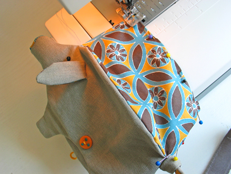Step 6.  Pin and sew together the bottom of the lining. Put the lining in his belly. This piggy is ready to be fed !
