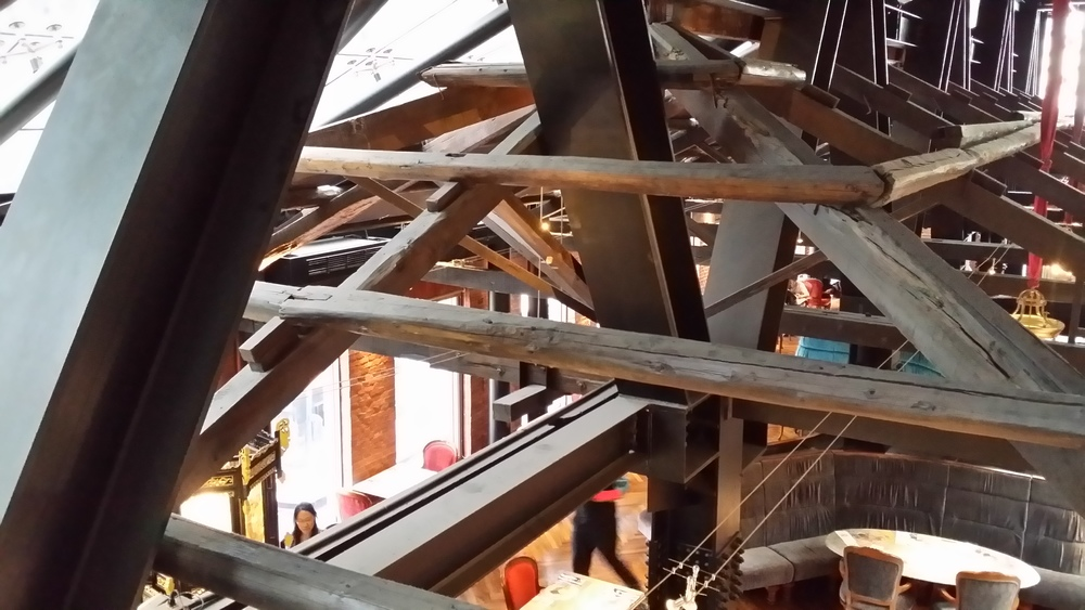 All the original roof timbers are retained and supported  to form  a canopy over the 3rd floor restaurant