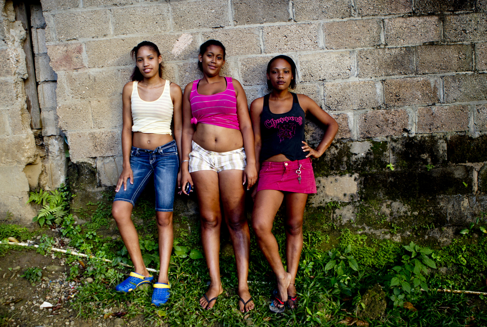 From left, Chabeli Mejia, 15, Yoldeidi Martinez, 20, and Berenise Nuñez, 23, are best friends, mothers and, like a lot of the local girls they know, sex workers. They help each other raise their children because the fathers are usually absent and they work the street together because it is safer than doing it alone.