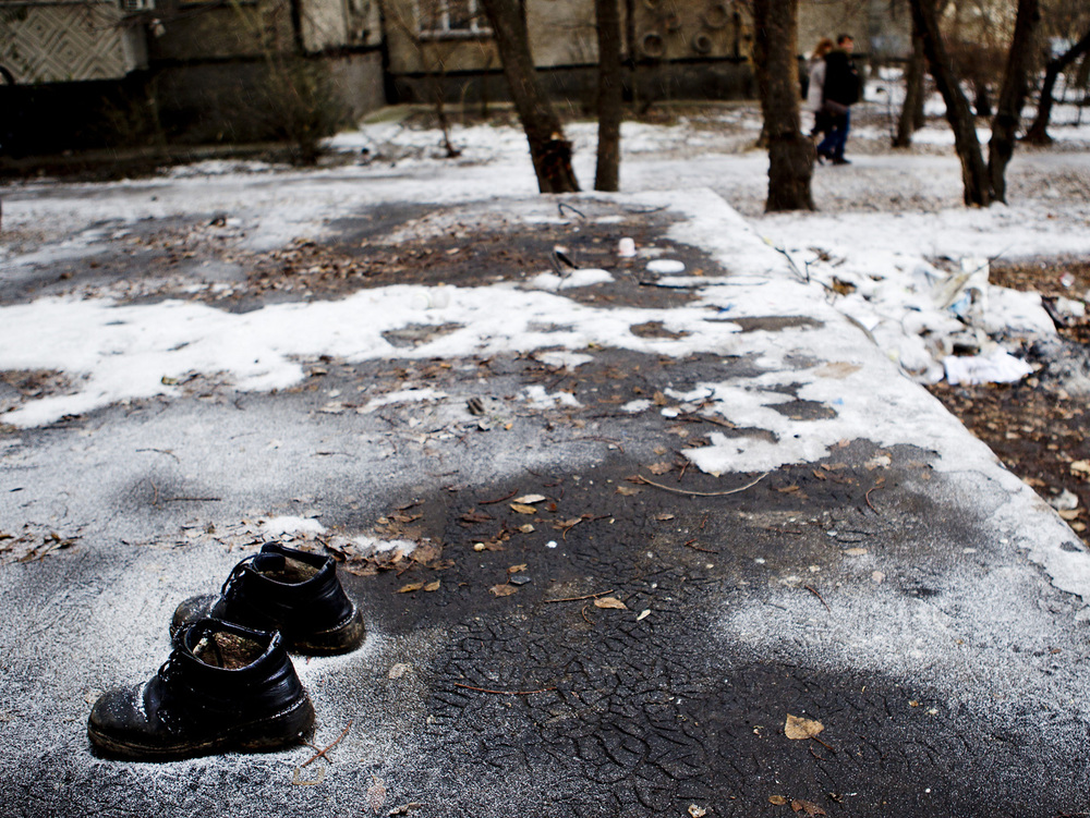 A pair of shoes left behind at a homeless gathering spot in Bishkek.