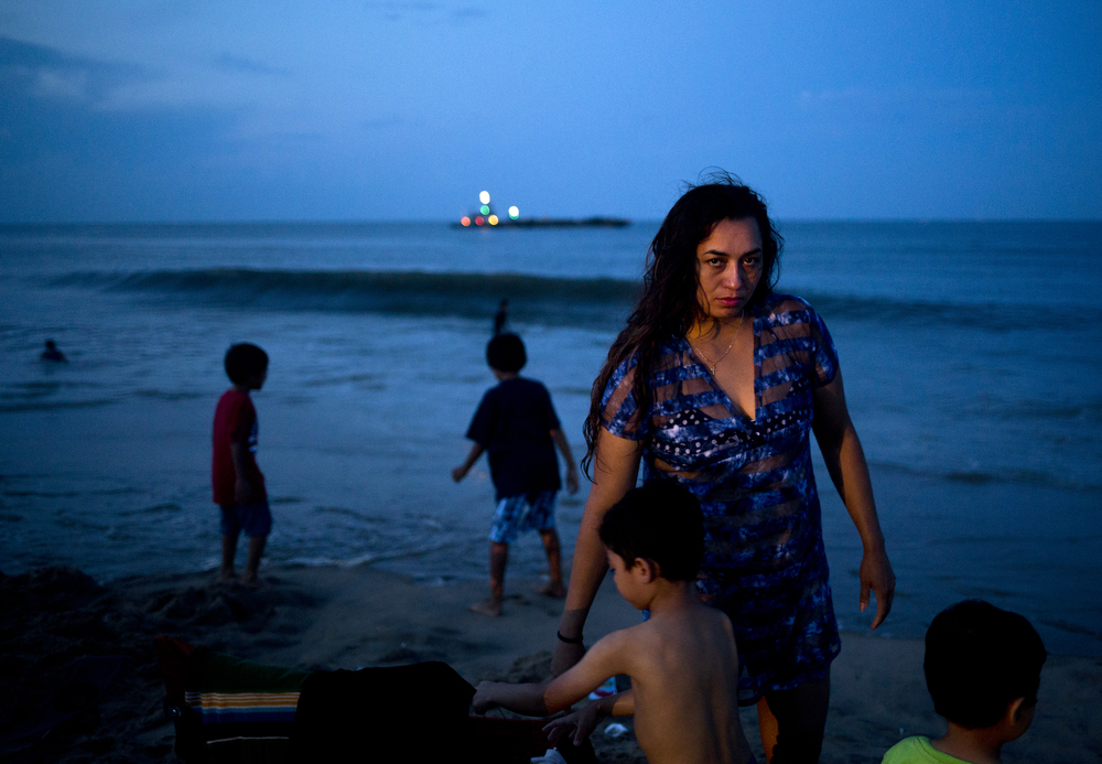 Blanca Castillo with her children at the Virginia Beach Oceanfront on the Fourth of July.