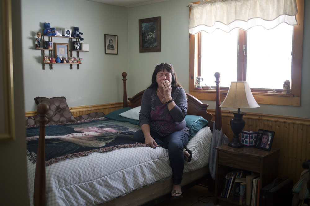 Gail McCarthy begins to cry as she sits in her daughter Ashley's old room at her home in Stetson, Maine. Gail lost not one, but two children to opioid overdoses. She found Ashley dead from a methadone overdose in her bed on Nov. 20, 2013, at 21 years old. Gail's son Matthew died 16 months later of an overdose on April 2, 2015. He was 24 years old.