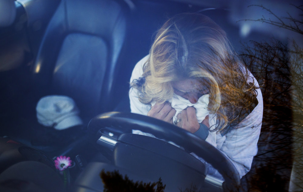 Ann Howgate buries her face in the blanket that the police covered her daughter's body up. Kristina Emard died in her car from an overdose on Sept. 25, 2016.She was 28 years old.