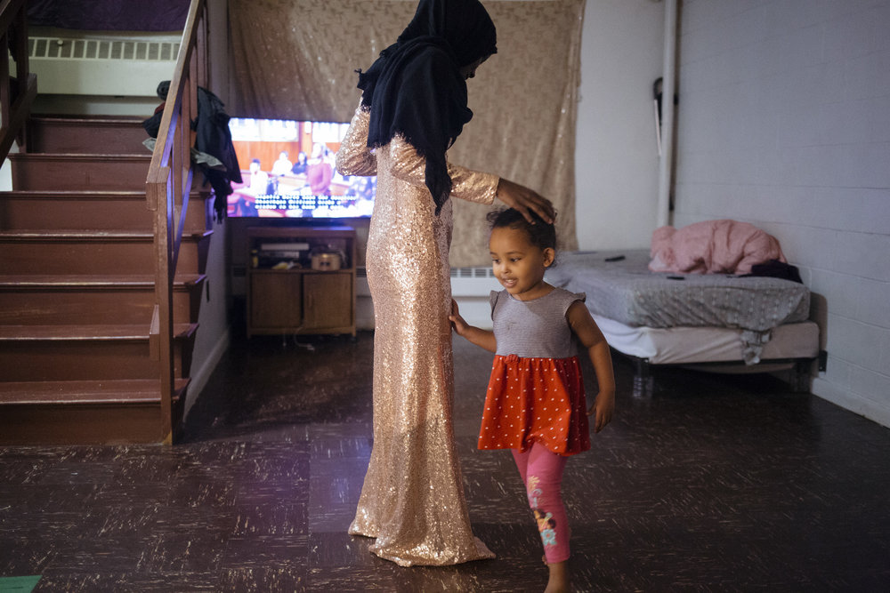 ZamZam, 2, runs circles around her aunt Hamdia Ahmed as Ahmed tries on her dress for the Miss Maine USA pageant at the apartkejt she lives in with her family in Portland.   In the Miss Maine USA 2018 competition Ahmed became the first Muslim woman to compete in the pageant in Maine while wearing a hijab. Ahmed, who is Somali, came with her family to the United States from the Dadaab refugee camp in 2005.