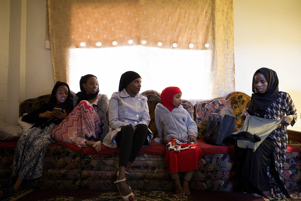"Hamdia Ahmed, at right, packs her suitcase before leaving for the pageant weekend surrounded by her family, from left, her nieces Muno, 10, and Naimo, 12, her older sister Arianna, and her niece, Zaytuun, 5.   Ahmed said she decided to do the pageant for two reasons: to open doors in the modeling world, and to open doors for other Muslim hijabi women on the Maine pageant scene. ""Representation matters,"" Ahmed said."