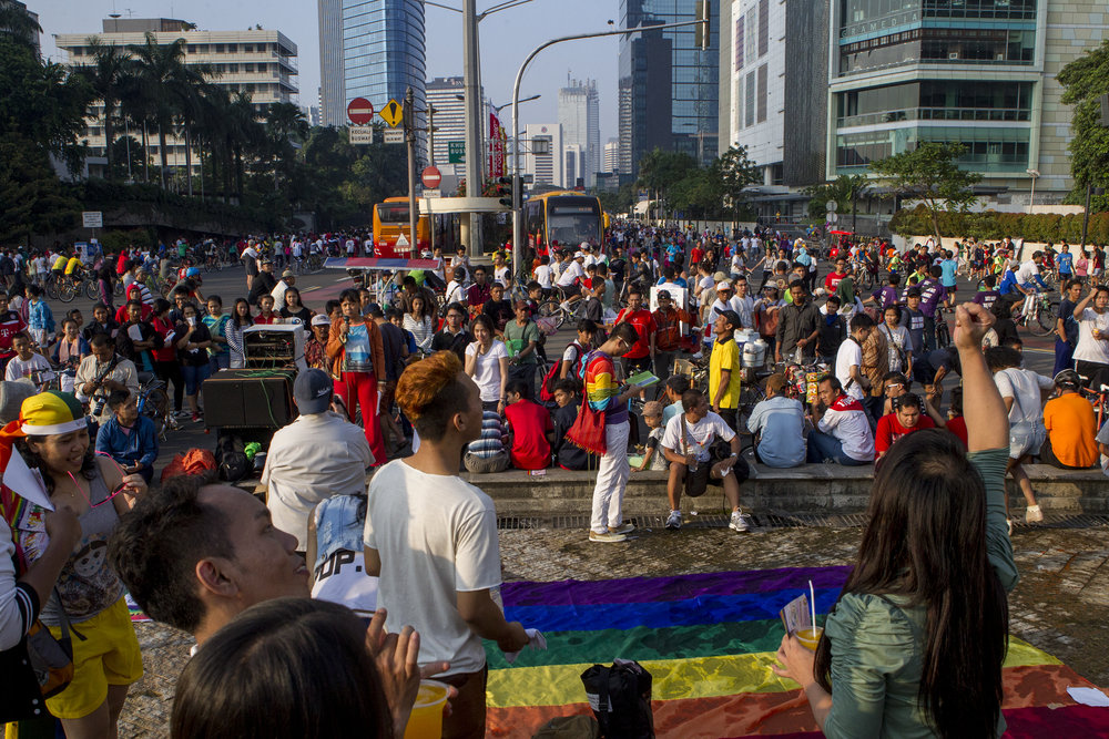 Visibility and recognition of the gay and waria communities in some parts of Indonesia have increased, but there is still a long way to go until they are seen and treated as equal.  Caption: An LGTBQ rally in the center of Jakarta.