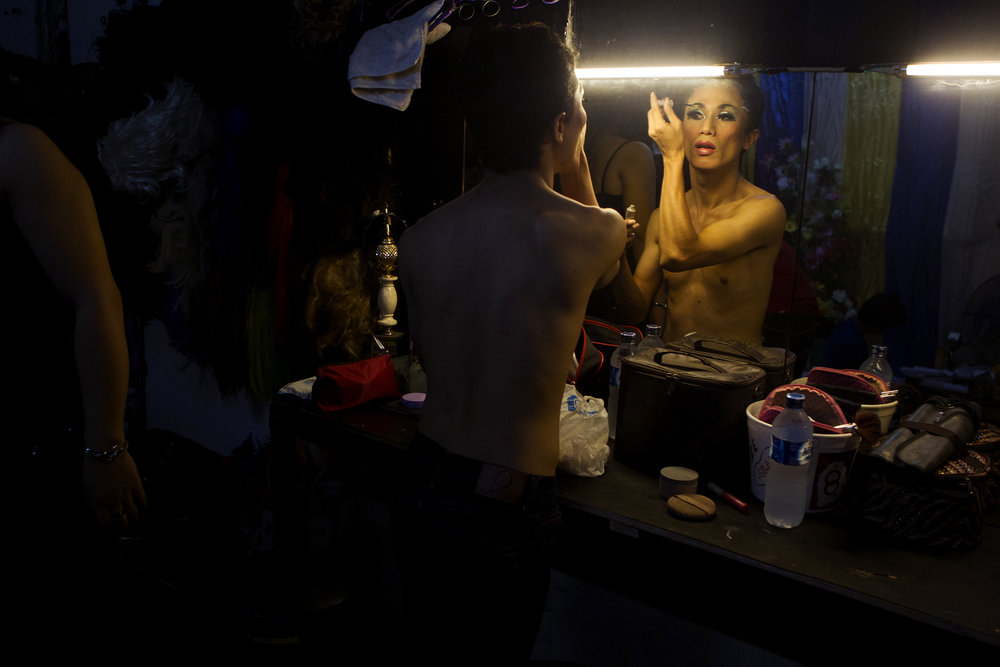"A performer gets ready for a show at a nightclub called Moonlight in Jakarta. The word waria is sometimes used to describe what would be considered a drag performance. Some performers only present as women for shows or at night, and others are ""full-time"" warias."